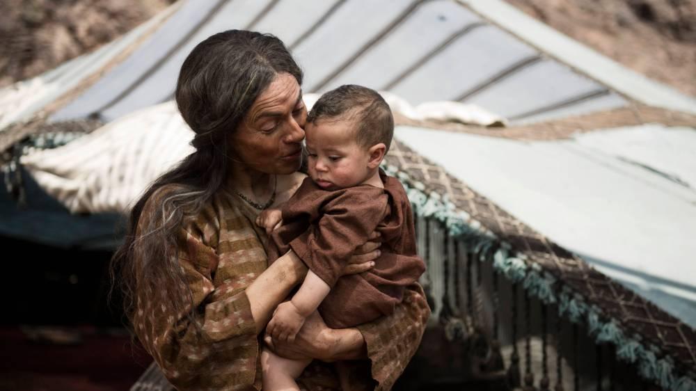 Scene 01/59 - Exterior Abraham's Encampment +1Year; Sarah (JOSEPHINE BUTLER) watches little Isaac grow up.